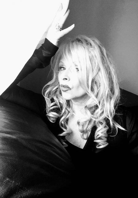 A New Blonde Bombshell is in Town. Elizabeth Ertel Settles the Movie Scores!
